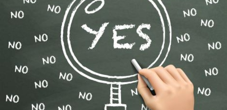 Chalkboard with yes and no written lots of times