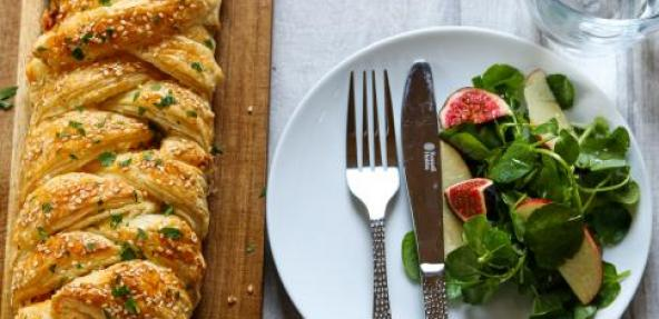 Paprika mustard leek and tofu plait next to a plate with salad.