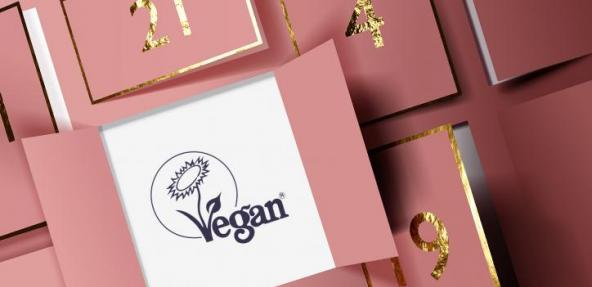 Pink advent calendar opening up to The Vegan Trademark