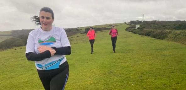 Amy running through field with friends
