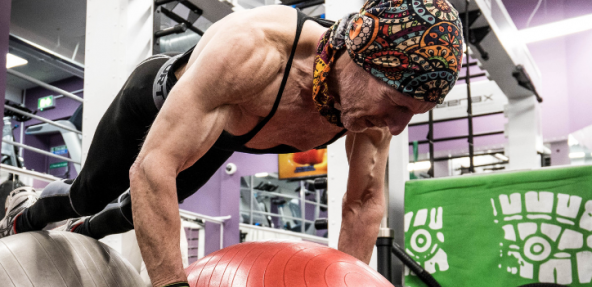 63 year old vegan doing a push up at the gym
