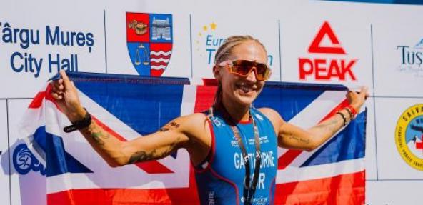 Vegan athlete Lisa Gawthorne holding up GB flag