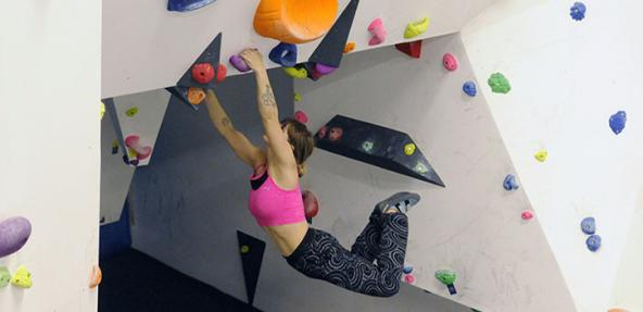 Two climbers doing indoor wall climbing