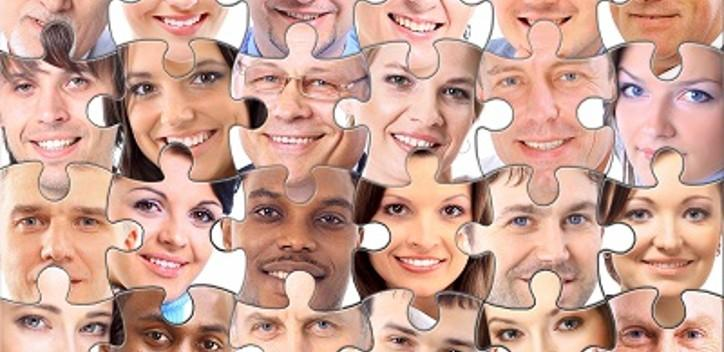 Faces of people joined together as a puzzle