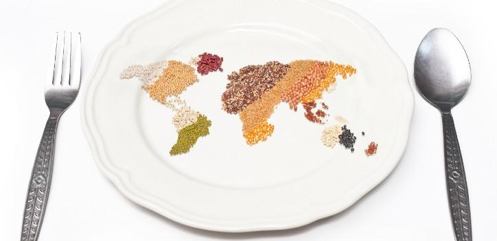 Map of the world made from grains and pulses on a plate