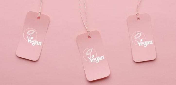 Labels with vegan written on them with pink background