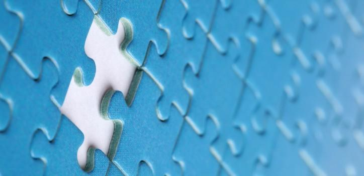 Blue jigsaw with missing peice