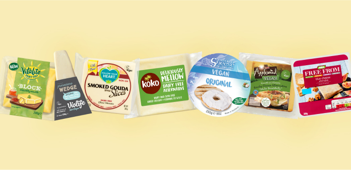 Selection of vegan cheeses imposed on a light yellow background