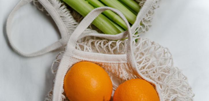 orange and celery in a net bag