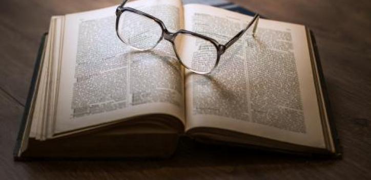 book; glasses; research
