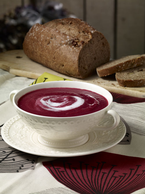 Beetroot soup with a swirl of coconut milk