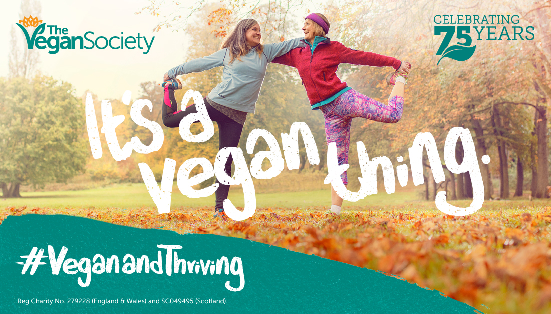 Two older women doing a yoga pose in an autumn park with 'it's a vegan thing' written over the top of the image