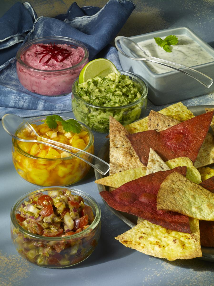 vegan tortilla chips with variety on dips