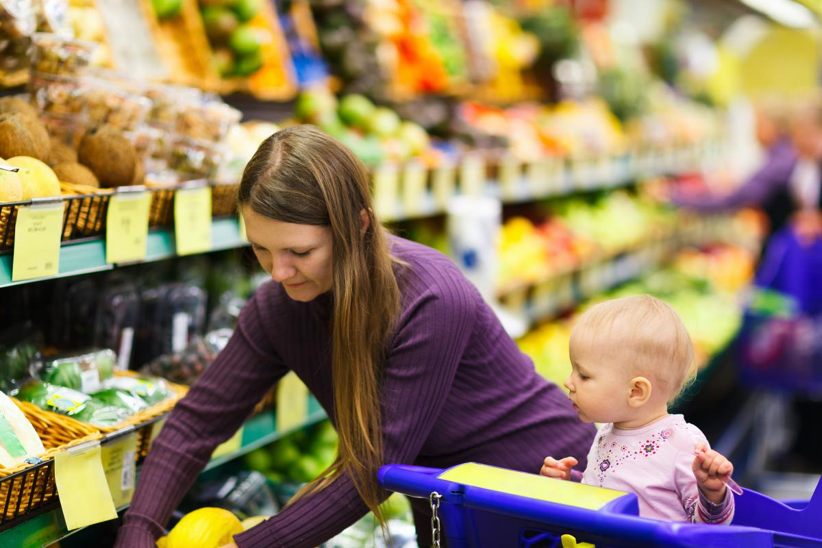 Woman and baby in supermarket