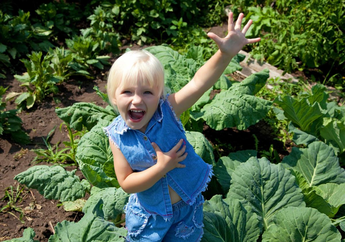 Child in veg patch