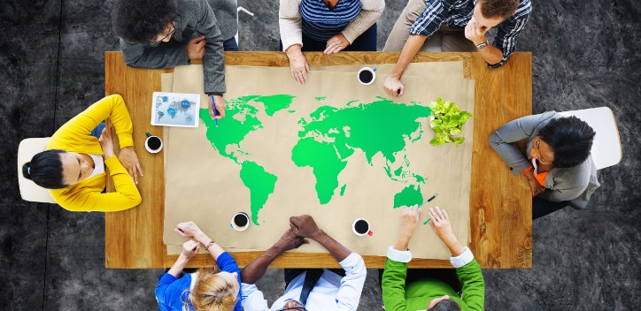 People working together on a world map